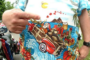 and another photo of santa giving fans a closeup view of his tropical hawaiian christmas shirt from beanteachercom - Christmas In Hawaiian